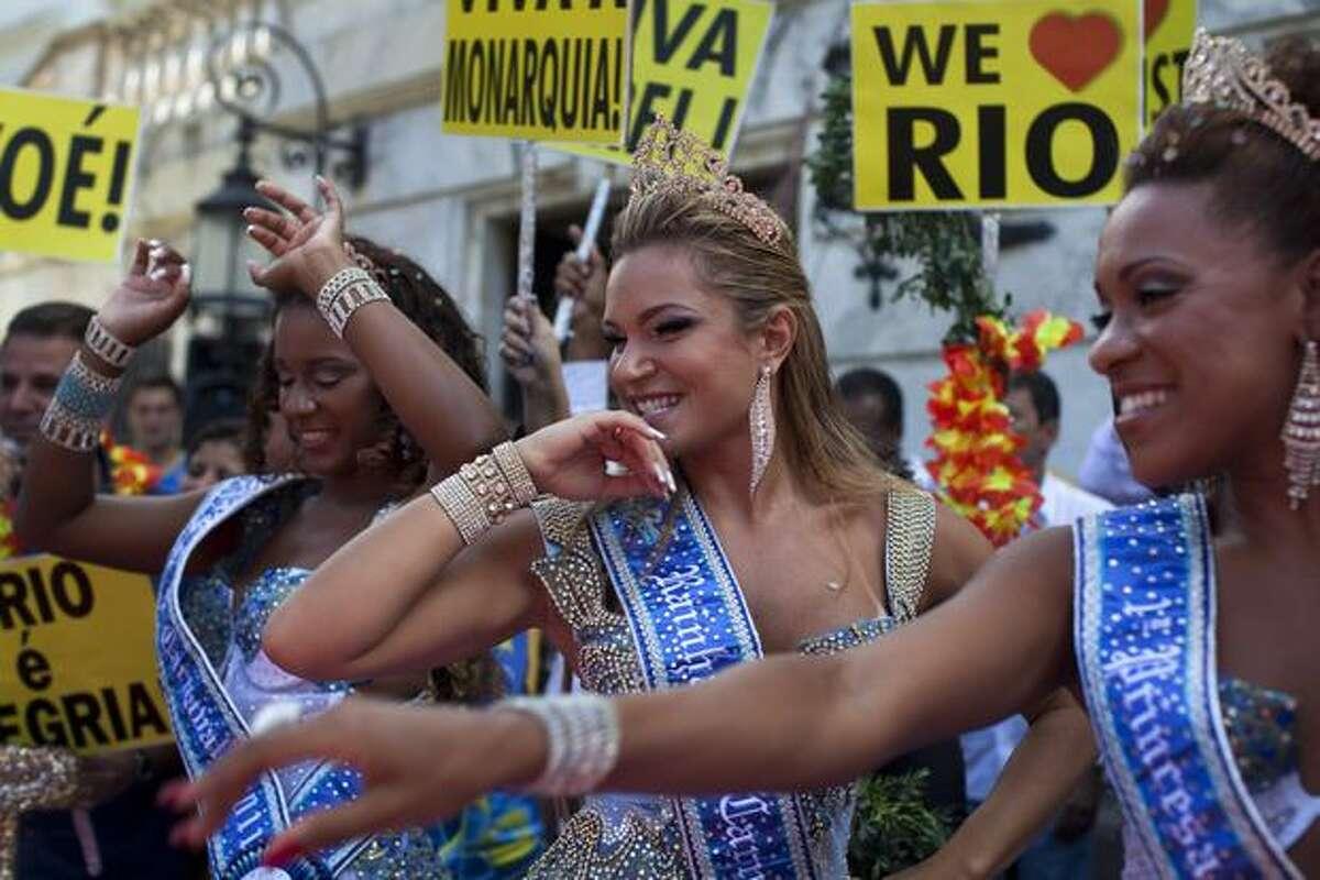Carnival queen and princesses dance during a ceremony officially opening Carnival season in Rio de Janeiro, Brazil, on Friday. (AP Photo/Rodrigo Abd)