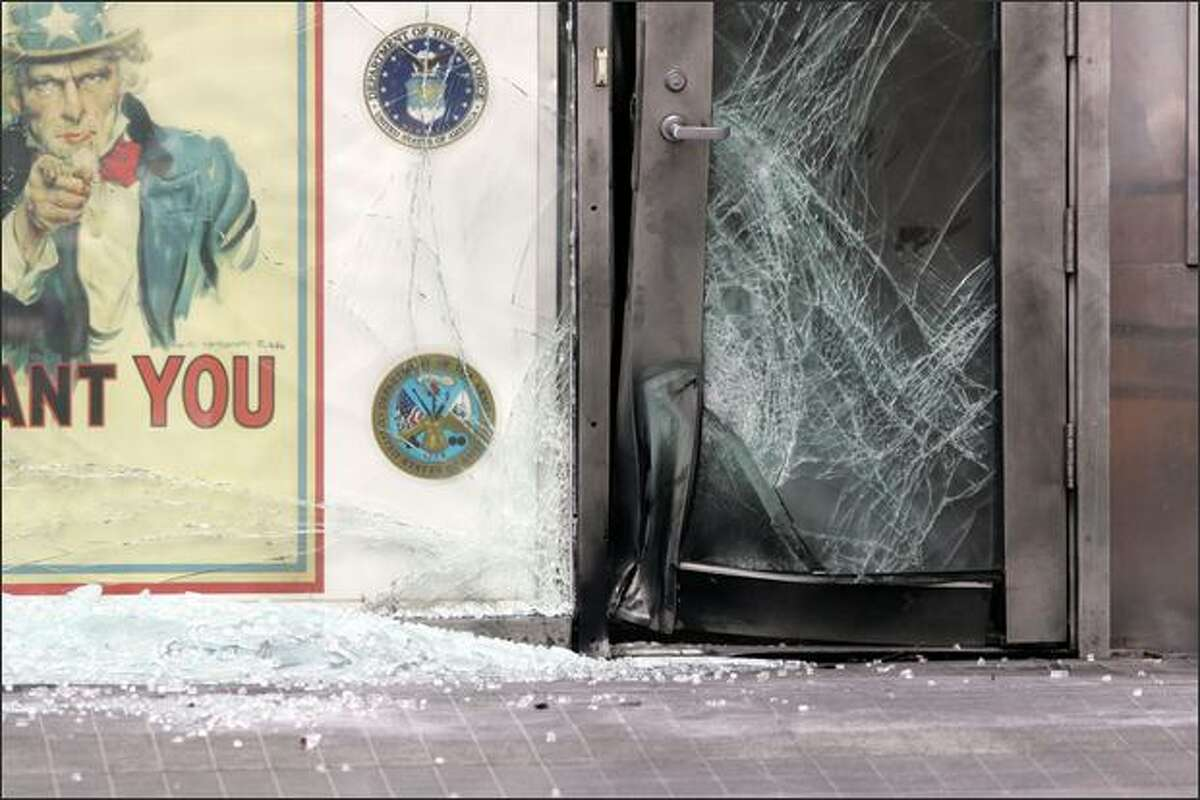 The entrance to a military recruitment station is damaged following an explosion in New York's Times Square Thursday. New York City police say some kind of explosive device was set off near the recruiting station located at 43rd Street near Broadway. No one was injured. (AP Photo/David Karp) - Story: NYC struck again by mystery bomber