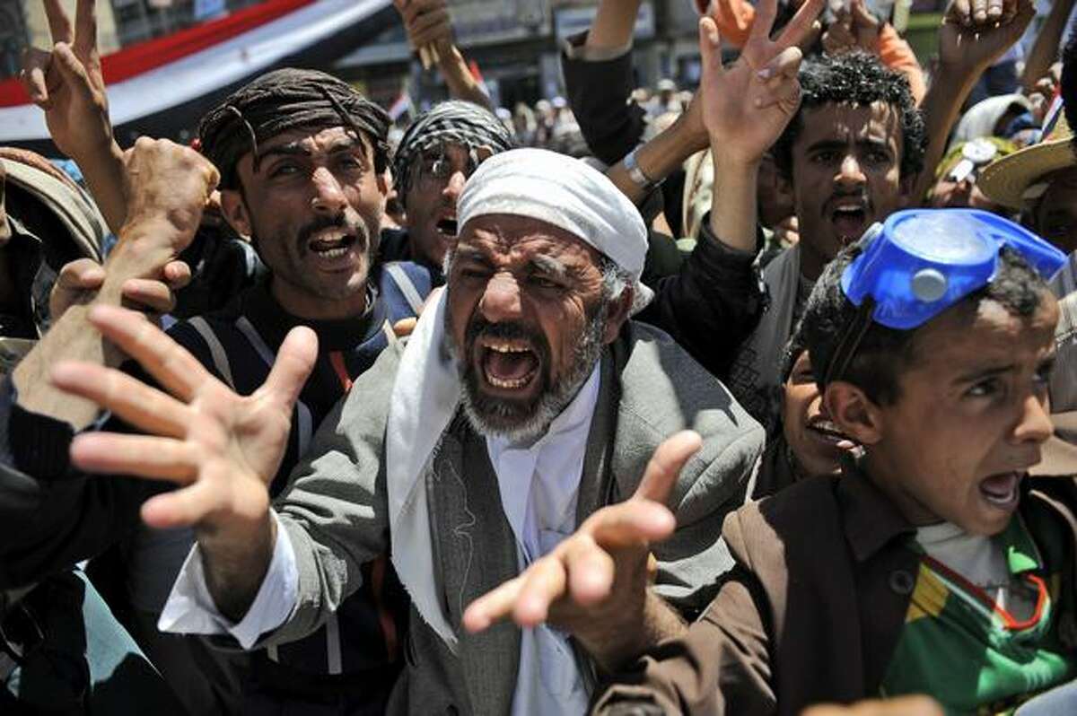 An anti-government protester reacts during a demonstration demanding the resignation of Yemeni President Ali Abdullah Saleh, in Sanaa,Yemen, Thursday, March 24, 2011. The leader of Yemen's largest tribe has announced his support for opposition demands that the country's longtime president step down. (AP Photo/Hani Mohammed)