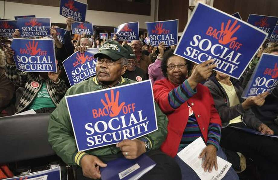 Social Security checks will still go out and field offices will continue to take death reports and applications for benefits, among other services. However, it can no longer issue a new or replacement Social Security or Medicare card or offer proof of income letters. Photo: Associated Press / Associated Press