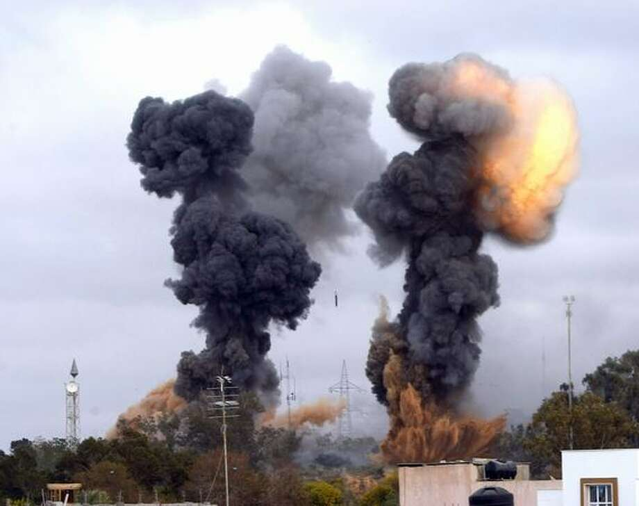 In this photo released by China's Xinhua news agency, heavy smoke rises over the Tajoura area, some 30 km east of Tripoli, Libya, after an airstrike on Tuesday March 29, 2011. (Xinhua/Hamza Turkia) Photo: Associated Press / Associated Press