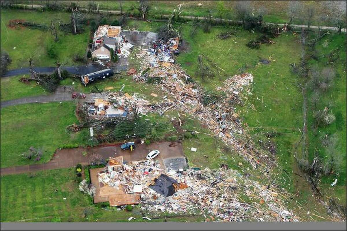 Homes are seen in the aftermath of a tornado, Friday, over Murfreesboro, Tenn. (AP Photo/The Tennessean, George Walker IV)