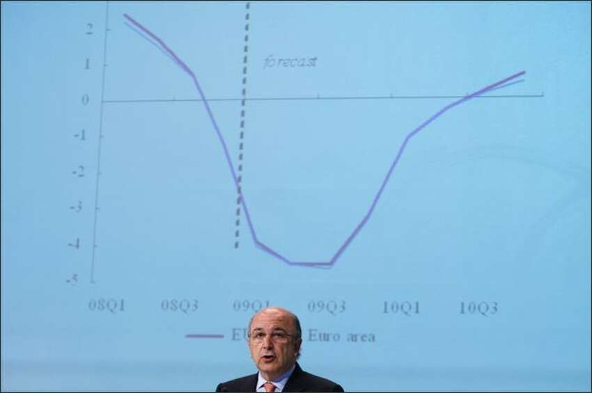 European Economic and Monetary Affairs Commissioner Joaquin Almunia presents the spring economic forecast during a news conference at the EU Commission headquarters in Brussels. Europe's economy will not start recovering until the second half of next year, the commission said on Monday as it slashed its forecasts to reflect the region's deepest recession since World War II.