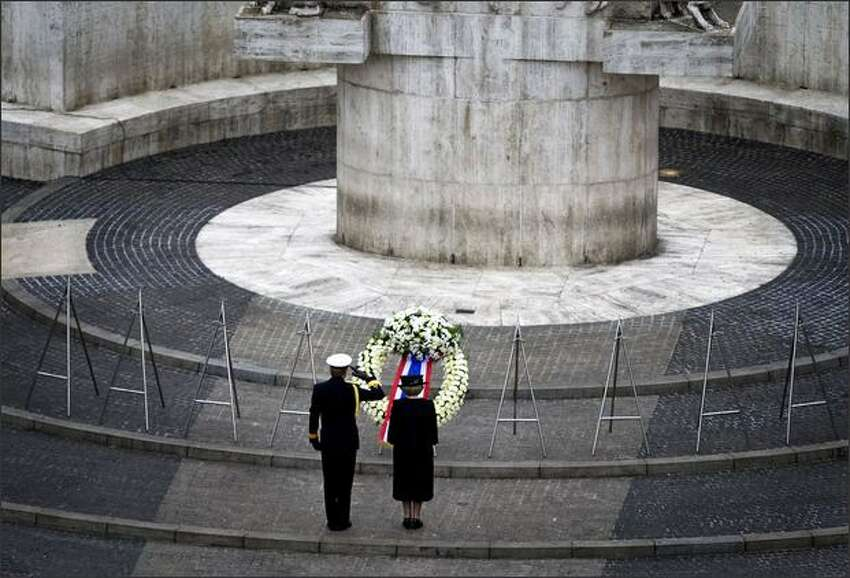Dutch Queen Beatrix, right, and Crown Prince Willem-Alexander stand after laying a garland at the National Monument in Amsterdam's Dam Square to commemorate those who have lost their lives during World War II. REUTERS/Olaf Kraak/Pool