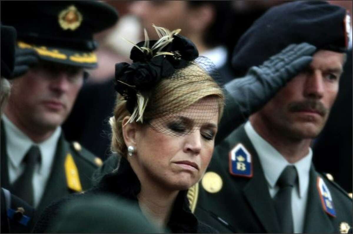 Argentine-born Princess Maxima, center, of the Netherlands, wife of Crown Prince Willem-Alexander, reacts during the National World War II Remembrance Day at the National Monument in Amsterdam. Security around the Dutch royal family has been tightened after a man rammed his car into onlookers at a parade in Apeldoorn last Thursday, narrowly missing an open bus carrying Queen Beatrix. Six people were killed and the driver died later from his injuries. REUTERS/Jerry Lampen