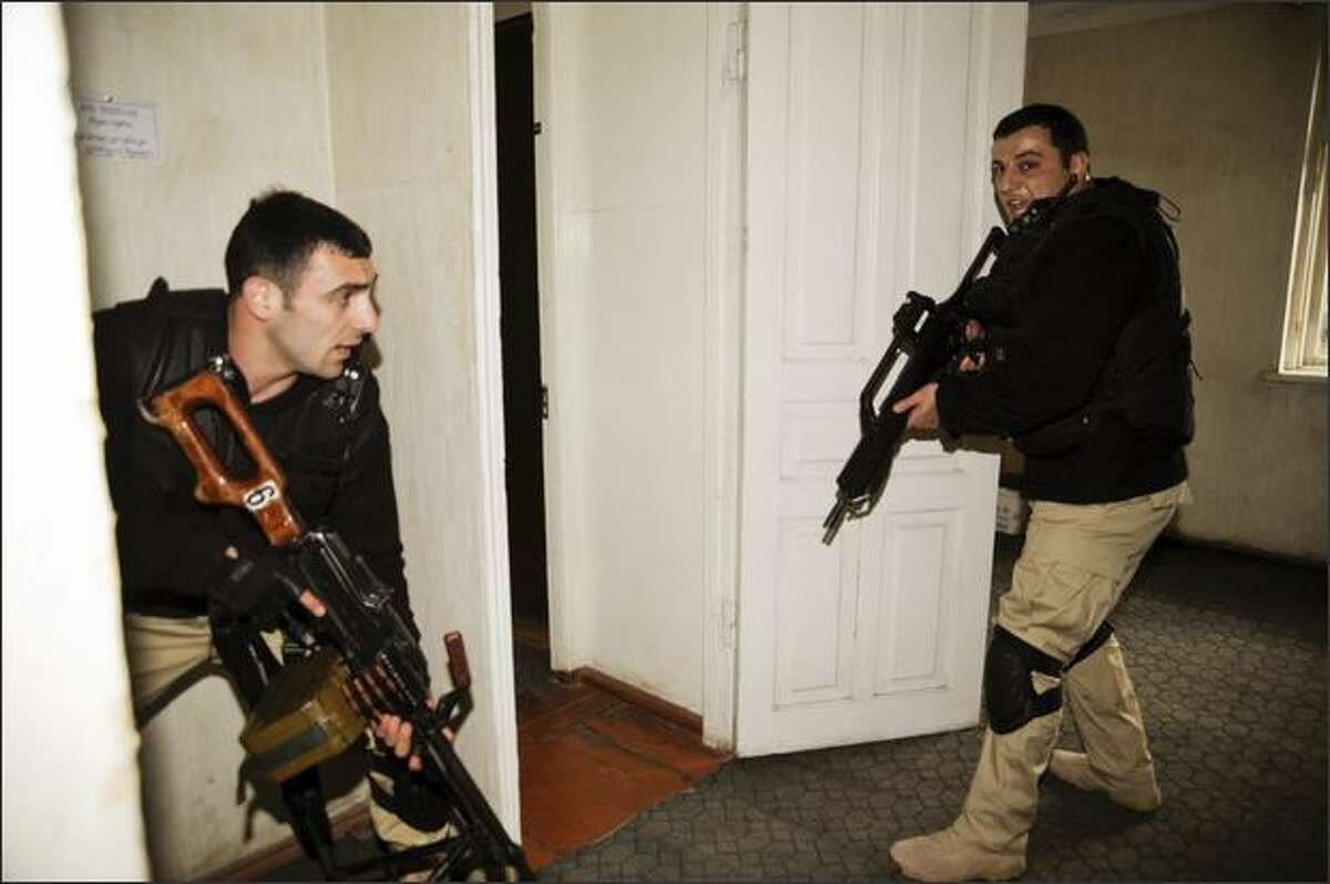 Presidential guards search offices in the Mukhrovani military base where some soldiers staged a mutiny, six miles east of Tbilisi May. Georgia put down a mutiny at a military base on Tuesday and accused Russia of financing a coup to stir up trouble on the eve of NATO war games in the ex-Soviet republic.