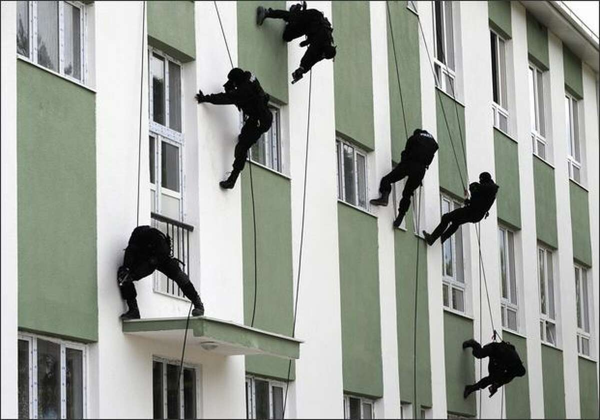 Special Forces policemen rappel down a building during a demonstration for Macedonian Police Day in Skopje. REUTERS/Ognen Teofilovski