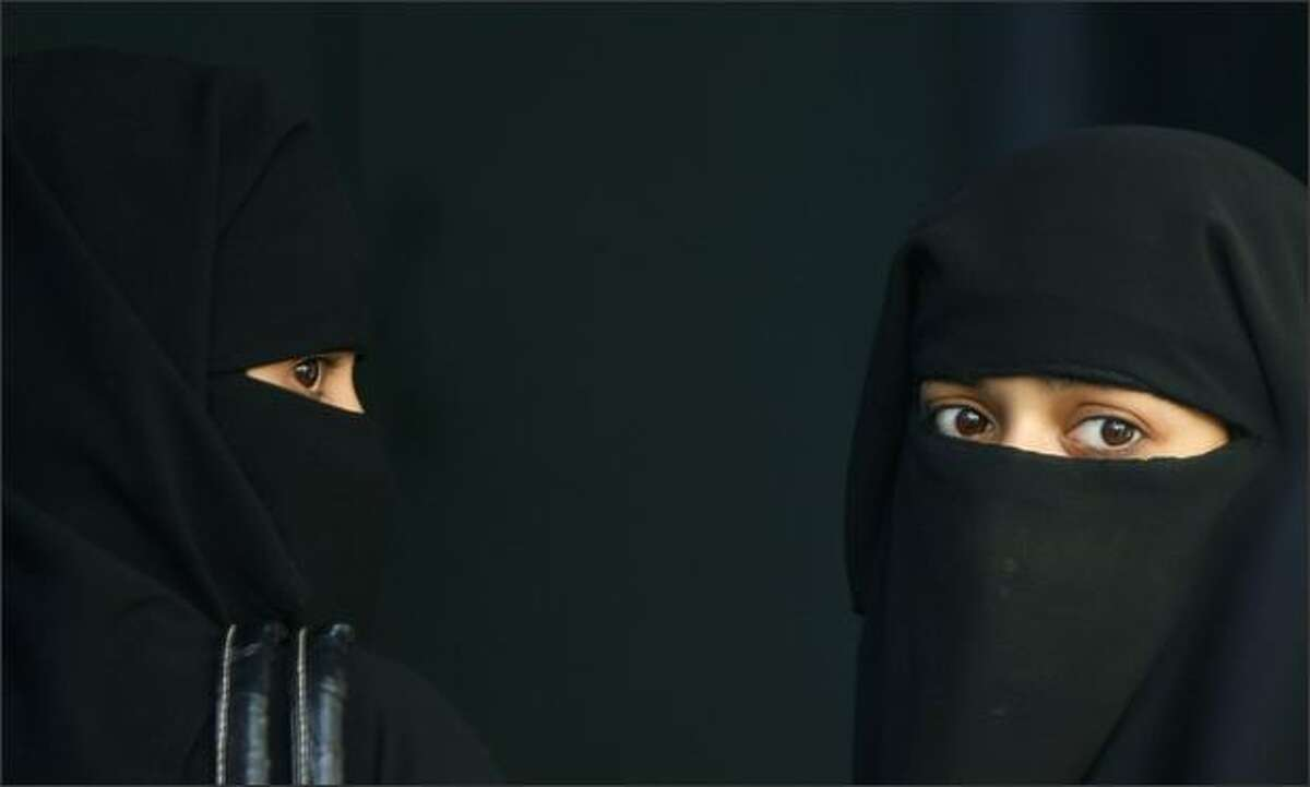 Muslim women wait for their turn to vote outside a booth at a polling station in the old quarters of Delhi. Millions of Indians began voting in the fourth round of a general election on Thursday, including the possible swing state of West Bengal where the ruling Congress-led alliance hopes to win crucial seats. REUTERS/Adnan Abidi