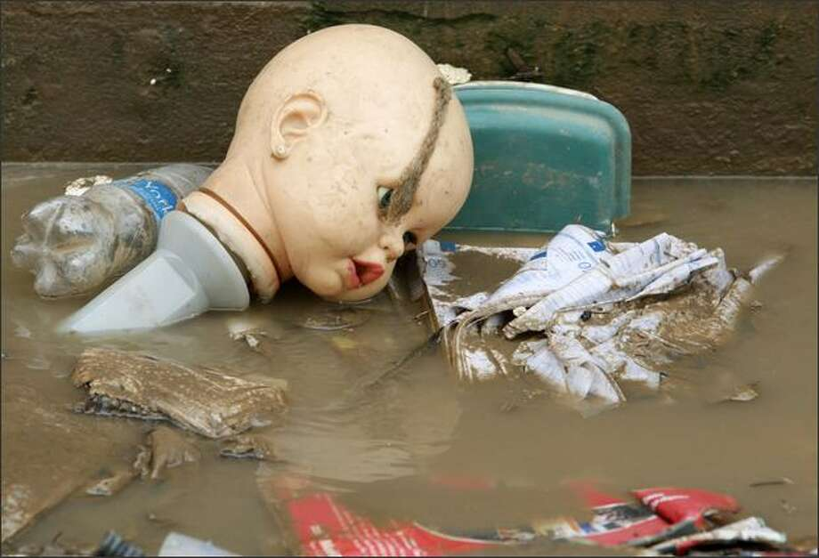 The head of a doll lies in a muddy puddle on a street in Teresina, Brazil. According to Brazilian Civil Defense, floods and mudslides from months of heavy rains in northern Brazil have driven more than 214,000 from their homes and killed at least 33 people. REUTERS/Paulo Whitaker Photo: Reuters / Reuters