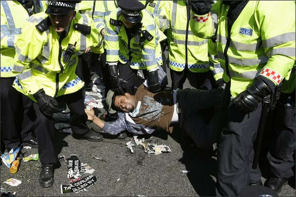 Police clash with pro-Tamil demonstrators in London's Parliament Square. REUTERS/Stefan Wermuth