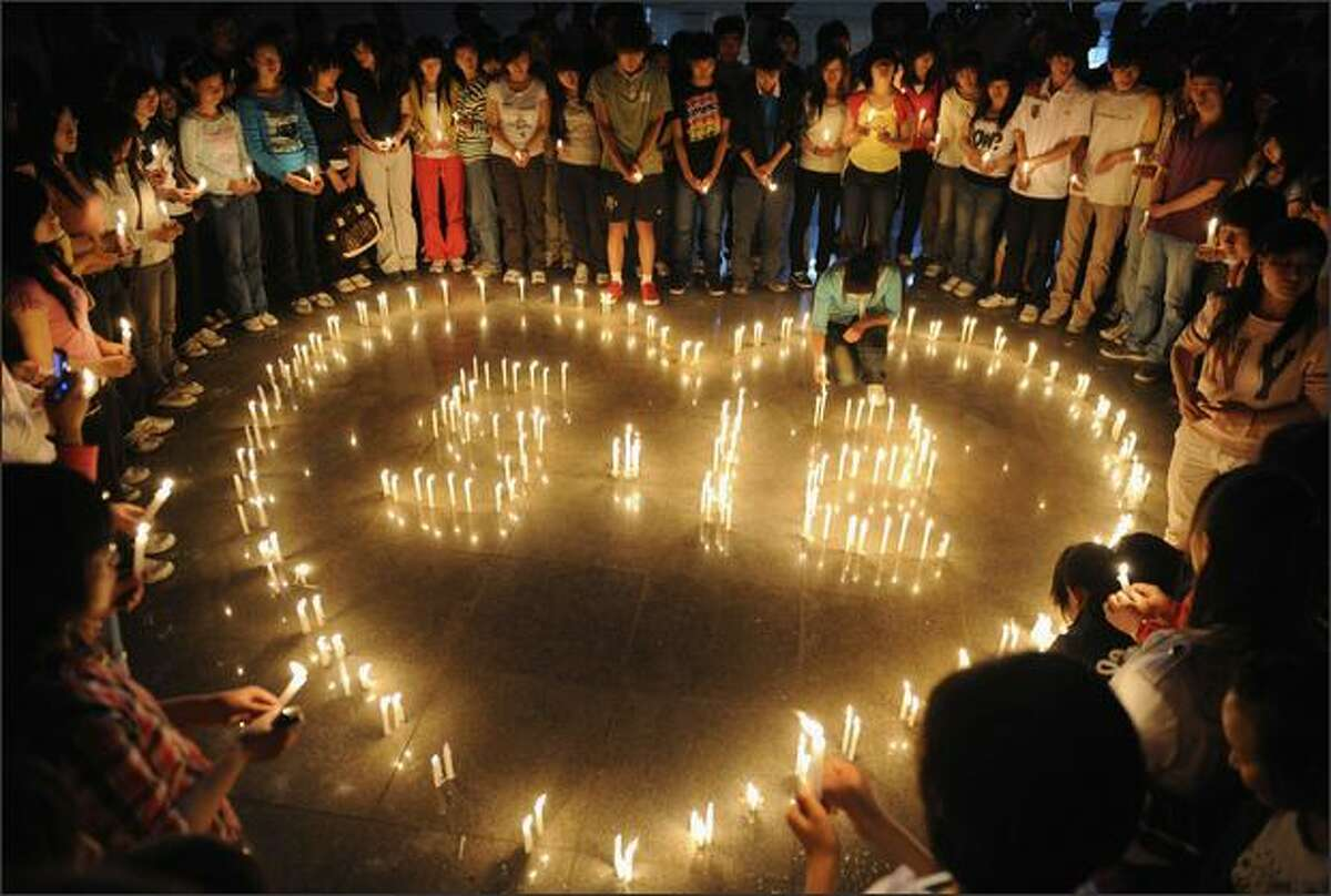 Students light candles in Taiyuan, China, to commemorate the May 12, 2008, earthquake in Sichuan province. REUTERS/Stringer