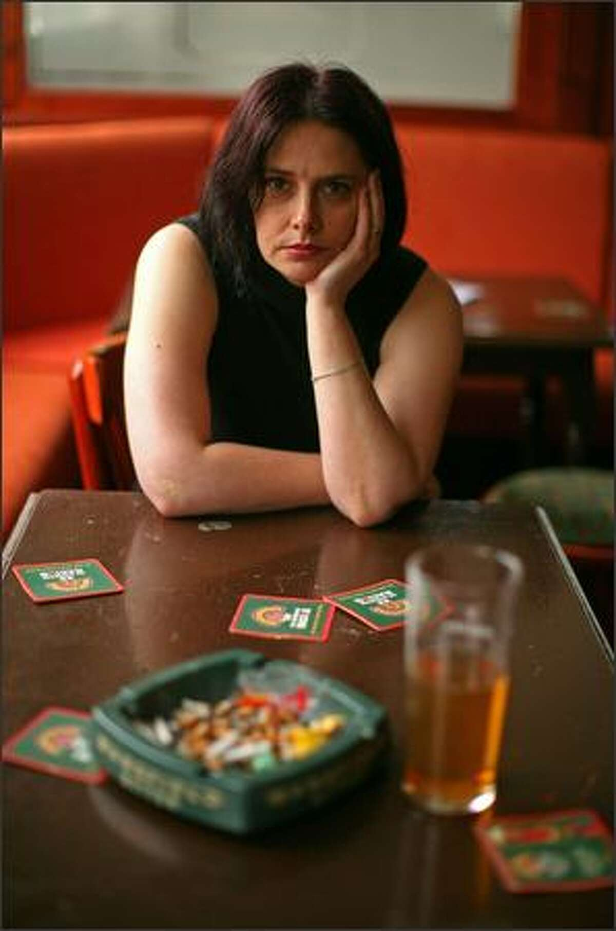 Kerry Fenton, of The Cutting Edge public house in Barnsley, England, poses at a table after her