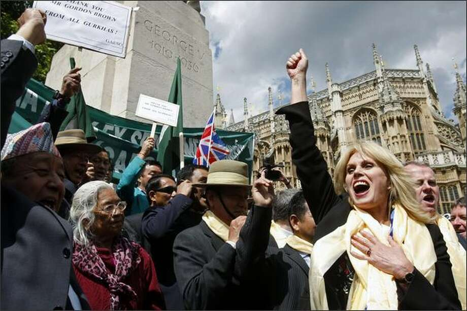 British actress and Gurkha rights campaigner Joanna Lumley, right, Gurkha veterans and supporters, react, outside the Houses of Parliament, in London, Thursday. The government announced Thursday that it will allow retired Gurkha veterans to settle in the country. (AP Photo/Sang Tan) Photo: Atlanta Journal-Constitution / Atlanta Journal-Constitution