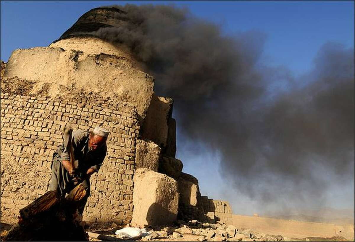 An Afghan worker cuts firewood to light a brick kiln in Kabul. Afghanistan's environment has been a casualty of the country's years of war, with pollution, deforestation and drought scarring the rugged country. Agencies will be using World Environment Day to raise awareness about some of the problems.