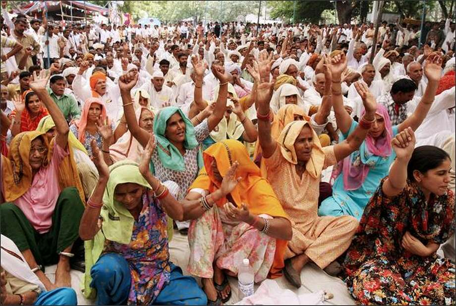 Protesting Indian Gujjar community members shout slogans during a demonstration in New Delhi. The Gujjar ethnic community wants the government to classify them as 'Scheduled Tribes' entitled to government jobs and education benefits. Since Gujjars started protesting in the western state of Rajsthan a few weeks ago, 37 people have lost their lives in clashes with police. Photo: Getty Images / Getty Images