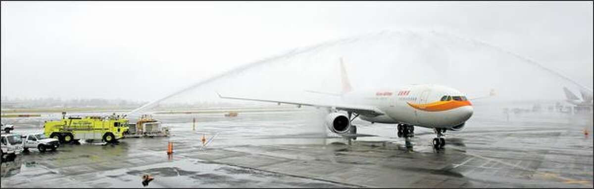 A Hainan Airlines arrives during a ceremony for Hainan's launch of nonstop service between Beijing and Seattle at SeaTac International Airport in Seatac on Monday.