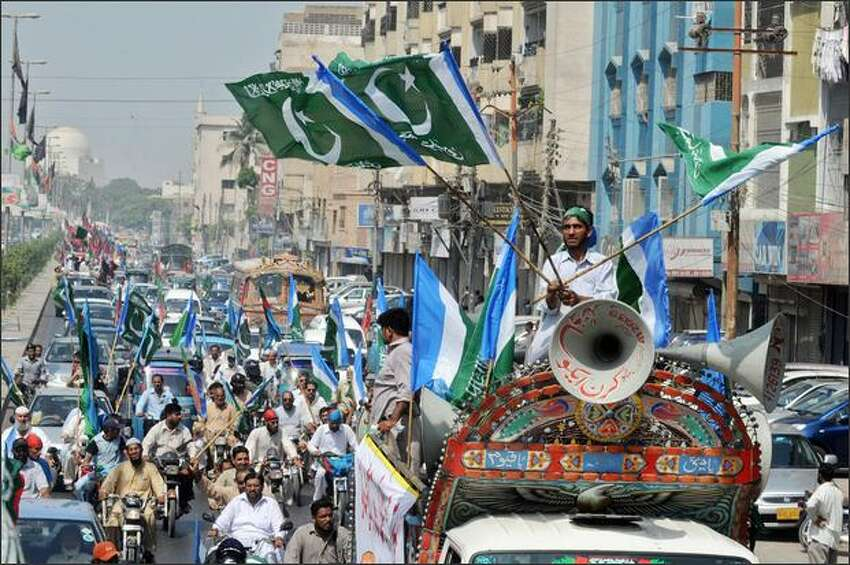 Pakistani lawyers and political parties activists sit on their vehicles during a rally against President Pervez Musharraf in Karachi on Monday. Thousands of Pakistani lawyers and other opponents of Musharraf embarked on a