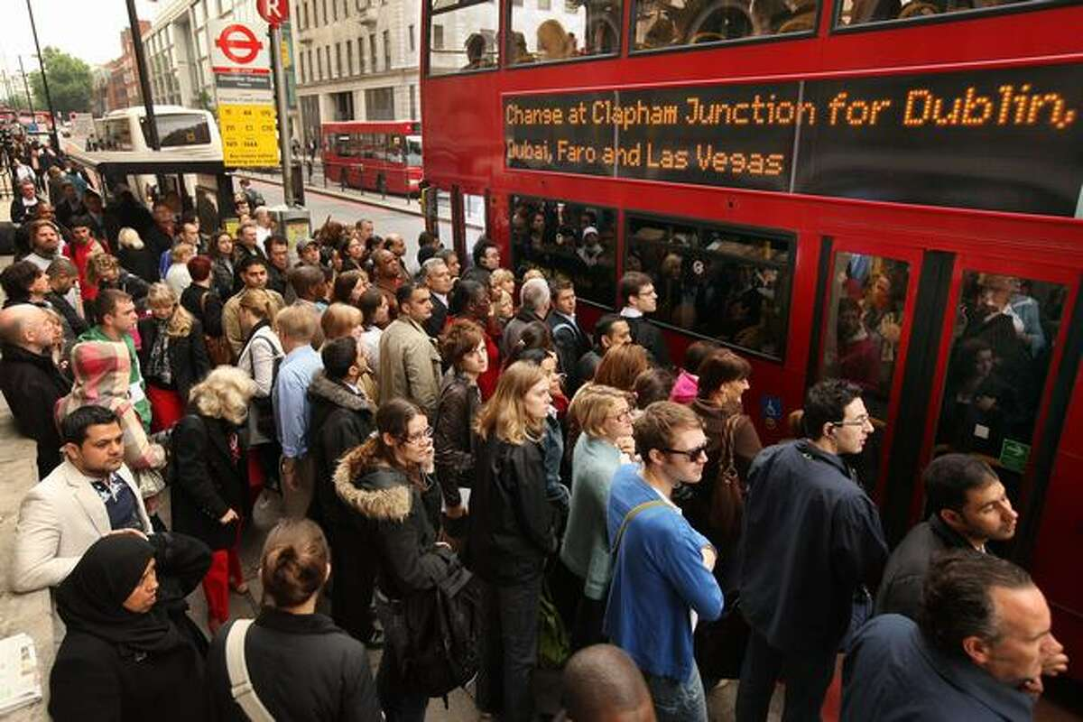 Commuters line up for buses outside London's Victoria Station after workers for the city's Underground subway system went on strike. A 48-hour walkout began Tuesday evening after discussions over pay and working conditions failed to reach a conclusion.
