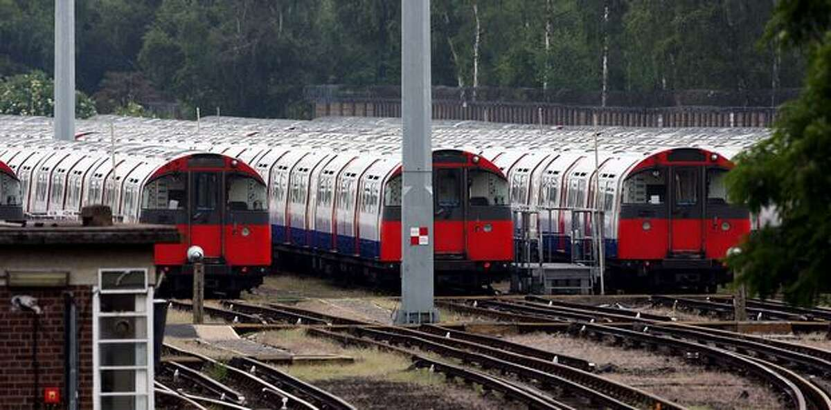 Subway cars from the Piccadilly line sit idle at Cockfosters train depot in London after Underground workers walked out on a 48-hour strike.