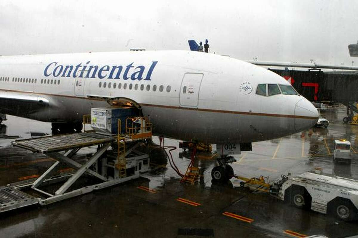 Continental Airlines Flight 61 sits on the ground at Newark Liberty International Airport in New Jersey. The plane landed safely after the pilot died en route from Brussels, Belgium, of natural causes.
