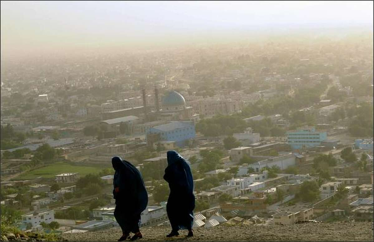 Afghan women walk on top of a hill in Kabul. Since the overthrow of the harsh Taliban regime which denied women and Afghan families most of common rights including the right to gather in public places, many places have emerged for amusement in post-Taliban Kabul.