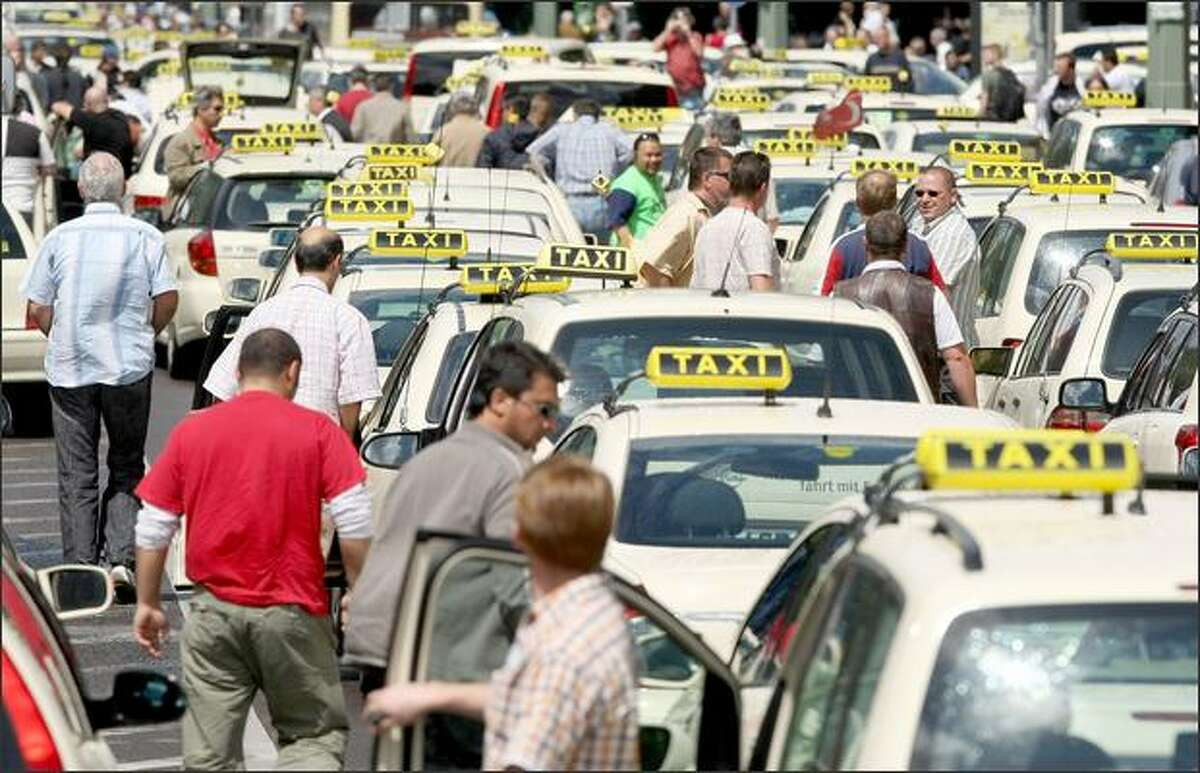 Protesting taxi drivers arrive at City Hall (Roter Rathaus) during a demonstration against rising gasoline prices on Tuesday in Berlin, Germany. Approximately 1,000 taxi drivers joined in the protest and demanded to be allowed to charge a EUR 0.50 surcharge per 10km as a means to counter the rising gas prices. Thousands of taxi drivers nationwide claim they face bankruptcy due to high fuel prices.