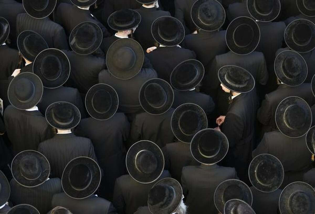 Thousands of ultra-Orthodox Jewish protest in Jerusalem's conservative neighbourhood of Mea Sharim during a demonstration against the opening of a car park during the Sabbath. A series of protests center on the decision by the municipality to require a car park outside the walls of the Old City to open on Friday and Saturday, when religious Jews observe a day of rest from sundown to sundown.