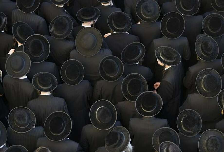 Thousands of ultra-Orthodox Jewish protest in Jerusalem's conservative neighbourhood of Mea Sharim during a demonstration against the opening of a car park during the Sabbath. A series of protests center on the decision by the municipality to require a car park outside the walls of the Old City to open on Friday and Saturday, when religious Jews observe a day of rest from sundown to sundown. Photo: Getty Images / Getty Images