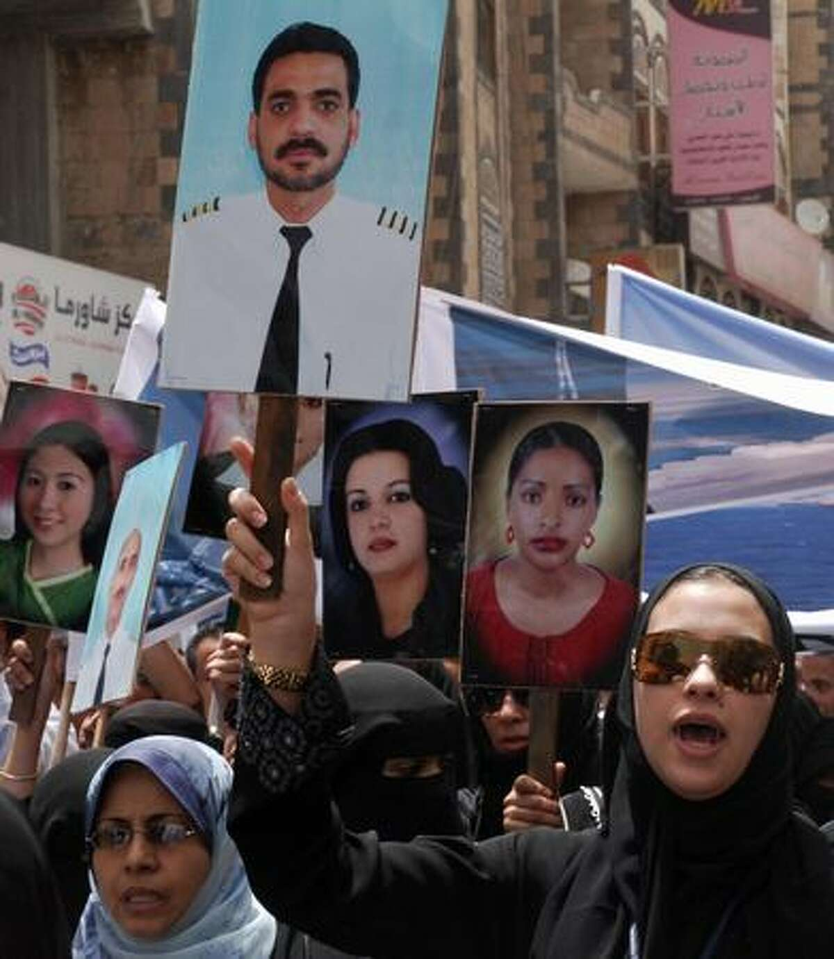 An employee of Yemenia airlines holds a picture of Khaled Hajeb, pilot of the national carrier's Airbus A310 that crashed last week off Comoros Islands in the Indian Ocean, during a protest in front of the French embassy on Sanaa. Hundreds of Yemenia airline employees demonstrated outside the French embassy in Sanaa protesting against French