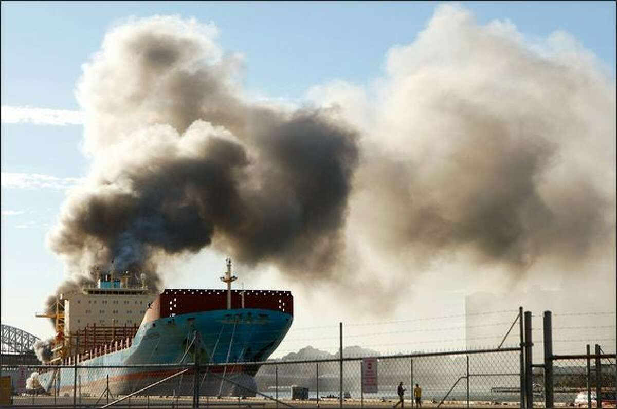 A fire is seen at the White Bay dockyard in Balmain on Wednesday in Sydney, Australia. Machinery inside the floating demountable work shed ignited the blaze onbaord where it was parked behind the 'Maersk Sealand' tanker at 8.30am.