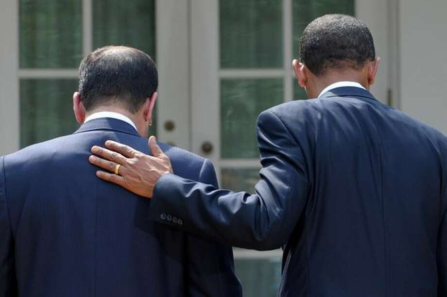 President Barack Obama and Iraqi Prime Minister Nouri al-Maliki leave a joint press conference in the Rose Garden at the White House. THis was the first meeting between Maliki and Obama since U.S. troops withdrew from Iraqi cities at the end of June, a milestone in Iraq's rehabilitation after the 2003 US-led invasion. Photo: Getty Images / Getty Images