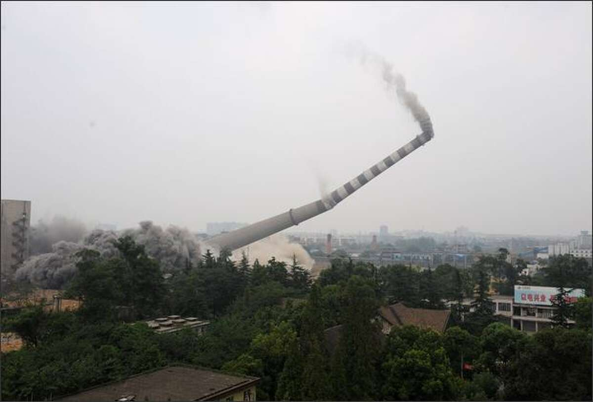 The chimney of Chengdu Huaneng Power Plant is demolished in Chengdu of Sichuan Province, China. The 688.8-foot-high chimney was demolished following the shutdown of the plant as part of Chengdu's project to reduce pollution.