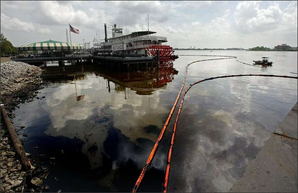 A sheen of fuel oil remains on the Mississippi River following a large spill in New Orleans, Louisiana. Two ships collided spilling over 400,000 gallons of industrial oil into the river dumping oil from New Orleans nearly 100 miles downriver to the Gulf of Mexico.