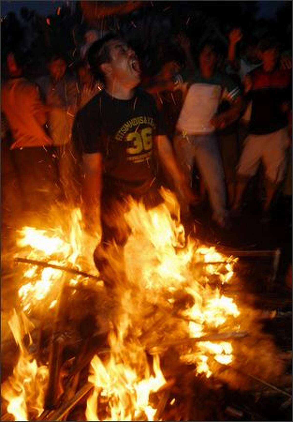 Nepalese students jump through a fire during a torch rally in Kathmandu in protest against vice president Parmananda Jha for taking the oath of office in the Hindi language. Students have been protesting against Jha for using the Hindi language during the swearing-in ceremony the previous week. The newly-republican Himalayan nation's Supreme Court ordered Parmananda Jha, who was sworn in last week, to explain his use of a foreign language.