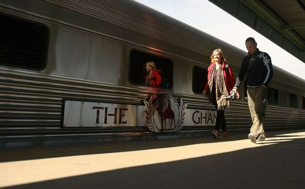 Passengers pass by The Ghan as it prepares for departure from Adelaide train station on Sunday in Adelaide, Australia. The commemorative trip from Adelaide to Darwin celebrates the 80th anniversary of The Ghan's travel through the heart of Australia alongside 80 years of the Australian Red Cross Blood Service. The Ghan first departed Adelaide bound for Alice Springs in August 1929, initially as a vitial outback transport link to the Red Centre, with this year's trip aiming to thank those who have given their support to the route over the past 80 years.
