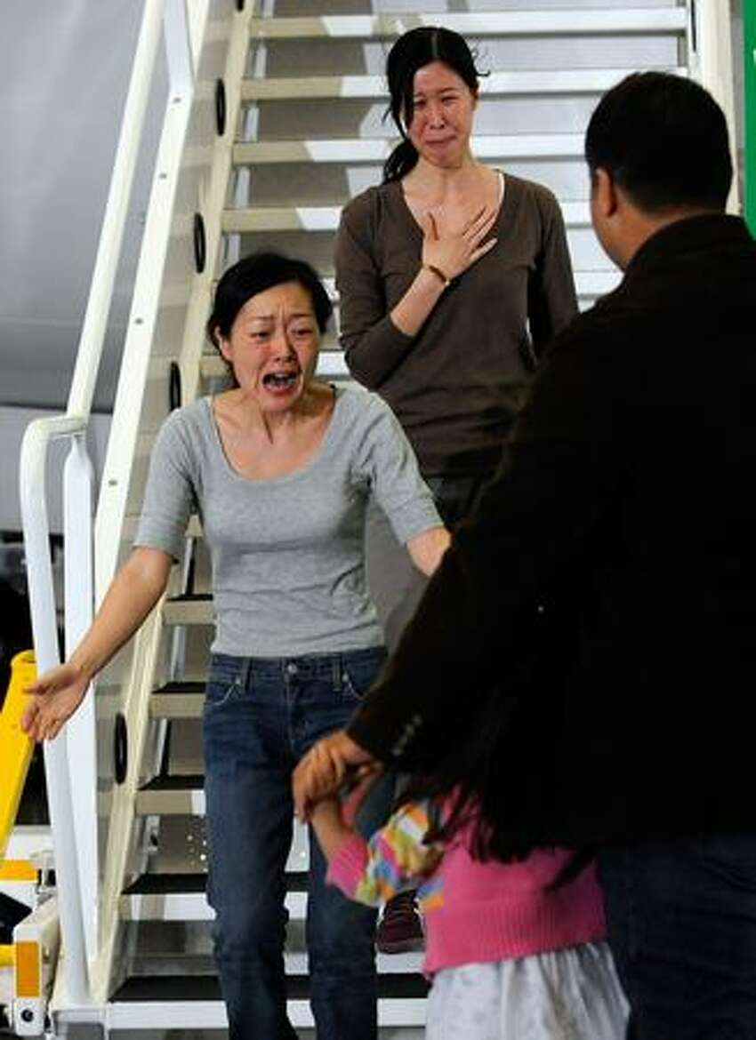Journalists Euna Lee and Laura Ling arrive in Burbank, Calif., for an emotional reunion with their families after being released by North Korean authorities Tuesday. Ling and Lee, of San Francisco-based Current TV, were both arrested by North Korea in March and sentenced to 12 years in prison for illegally entering the country. They were pardoned Tuesday by President Kim Jong-Il after a meeting with former U.S. President Bill Clinton.