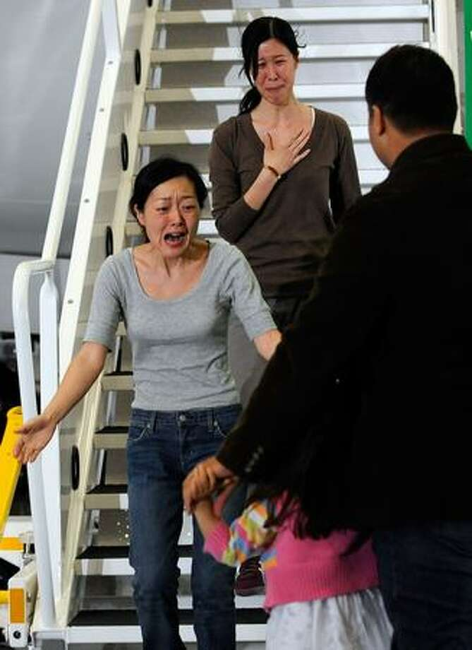 Journalists Euna Lee and Laura Ling arrive in Burbank, Calif., for an emotional reunion with their families after being released by North Korean authorities Tuesday. Ling and Lee, of San Francisco-based Current TV, were both arrested by North Korea in March and sentenced to 12 years in prison for illegally entering the country. They were pardoned Tuesday by President Kim Jong-Il after a meeting with former U.S. President Bill Clinton. Photo: Getty Images / Getty Images