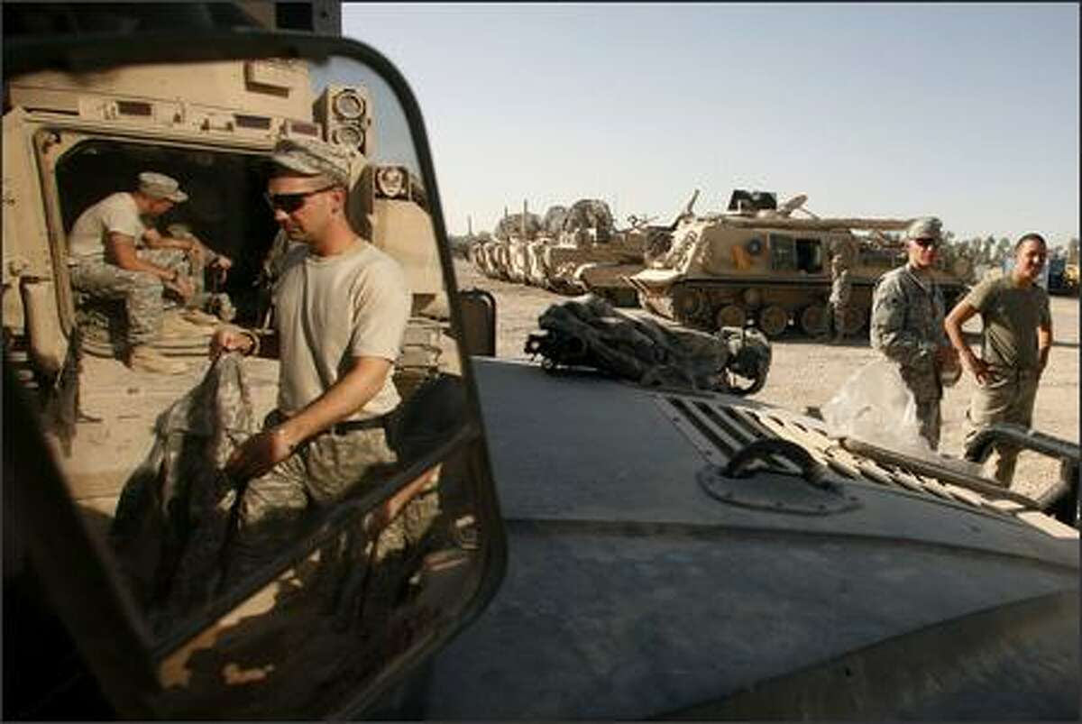 U.S. Army troops from Alpha Company, 1st Battalion, 5th Cavalry Regiment, 2nd Brigade, 1st Cavalry Division get ready for an operation in the Amariyah neighborhood of west Baghdad, Iraq on Tuesday, Aug. 14, 2007. AP Photo/Petr David Josek