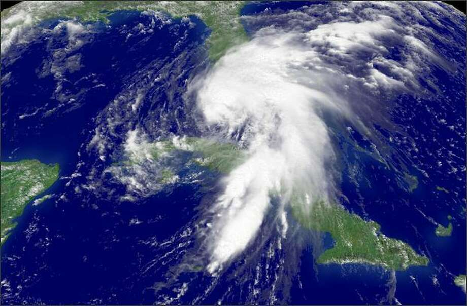 In this satellite image provided by the National Oceanic and Atmospheric Administration (NOAA), Tropical Storm Fay churns across the Caribbean Monday towards the Florida Keys, Florida. Fay wreaked havoc through the Dominican Republic, Haiti, Jamaica and Cuba before moving on to threaten the Florida Keys, where it is expected to hit sometime during the night. - Story: Tropical Storm Fay begins to lash Florida Keys Photo: Getty Images / Getty Images