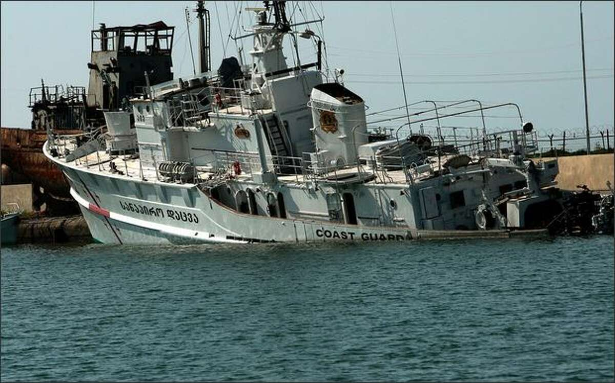 A Georgian Coast Guard vessel sits half-sunk in the port of Poti on Monday near Poti, Georgia. Russian forces sank several Georgian military ships when hostilities between Russian and Georgia began a week ago. - Story: Rice says NATO will defeat Russian aims in Georgia
