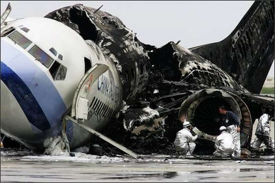 A China Airlines aircraft Boeing 737 lies in ruins at Naha Airport August 20, 2007 in Okinawa, Japan. The aircraft's left engine exploded after landing following it's flight from Taiwan. Despite the resultant fire destroying the plane all 165 people on board escaped safely. Photo by Getty Images