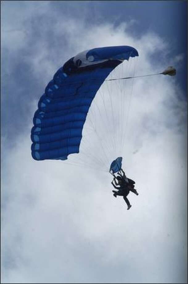 "Fred Winter, an 89 year-old World War II veteran from Houston, makes his descent during his first skydive at Skydive Spaceland on Friday in Rosharon, Texas. Winter, whose leg was amputated during to a hunting accident, said: ""I did this jump not for the thrill of jumping out of a plane. I did it so other amputees would see that life goes on after losing a limb and for people to remember that we have a war going on and we need to treat these veterans with respect.""(AP Photo/Houston Chronicle, Johnny Hanson)"