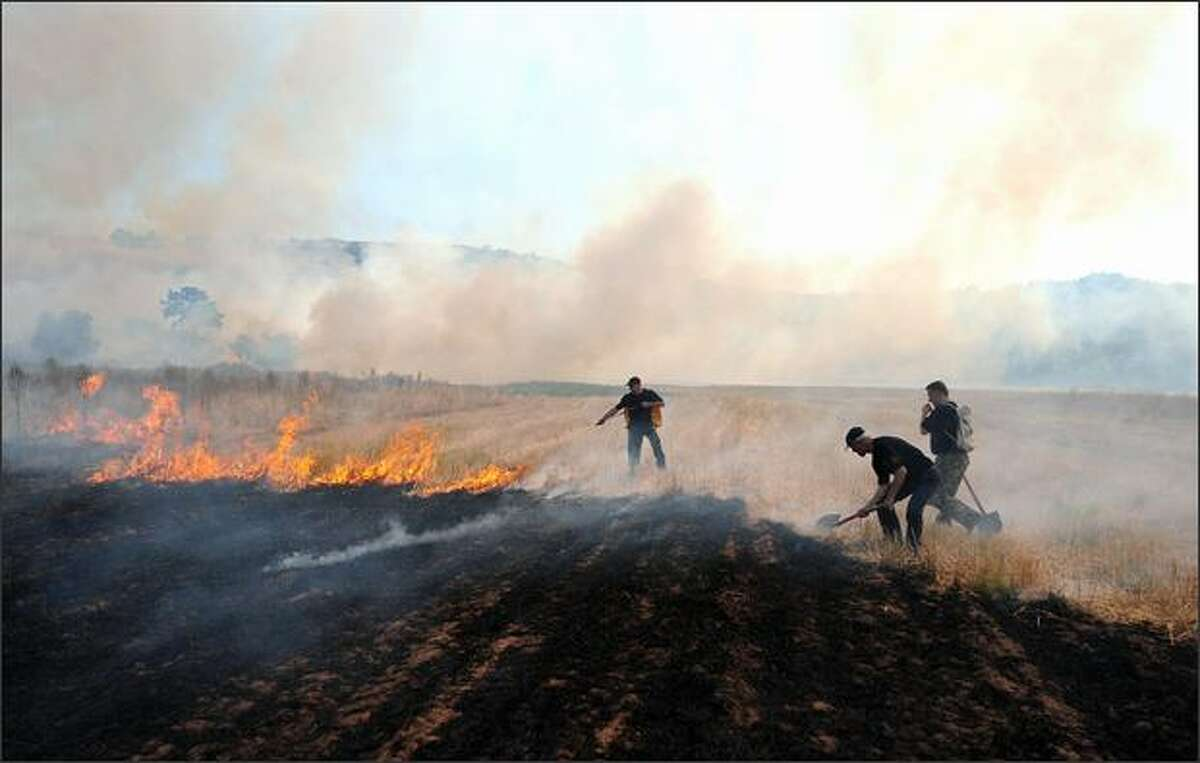 Firemen and villagers try to put down the major forest fire in the Poreche area, near the town of Makedonski Brod in central Macedonia,on Tuesday. The hot, dry weather, coupled with warm winds, created the conditions for forest fires, which attacked the country. This year is still a far cry from the disastrous 2007, when the country was faced with several major fires at a time.