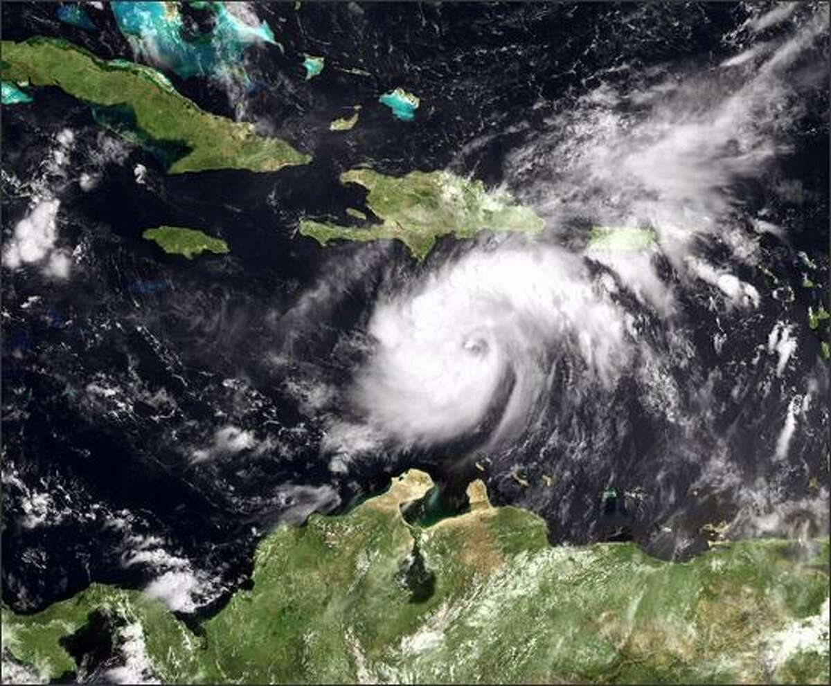 In this satellite image provided by the National Oceanic and Atmospheric Administration (NOAA), Tropical Storm Gustav threatens to unload heavy rain and 60 mph winds over the island of Haiti 14:45 GMT Monday. Gustav is the seventh named storm of the 2008 Atlantic hurricane season and is expected to be upgraded to a hurricane.