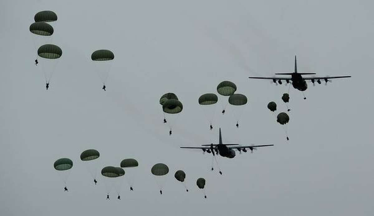 Australian soldiers parachute during an airborne-combat team exercise as part of a training activity on Sept. 6, 2010, in Charters Towers, Australia. The soldiers made the jump from C-130 Hercules and C-17A Globemaster aircraft.