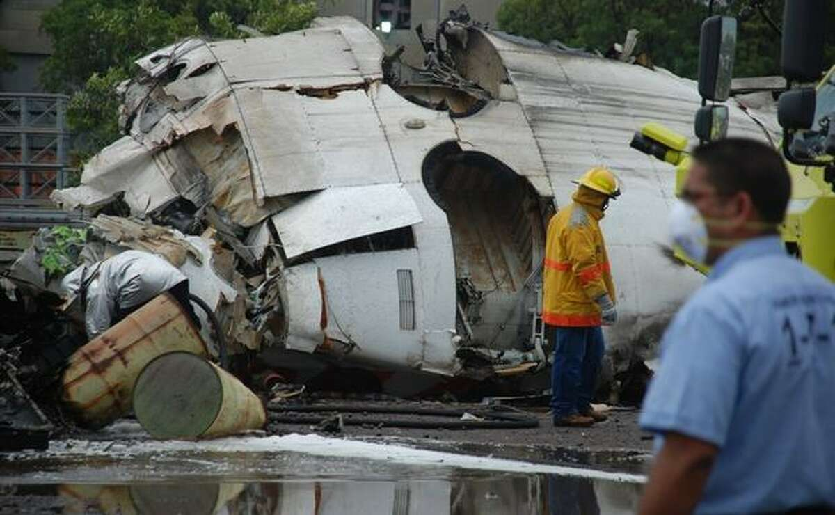 A firefighters search into the wreckage of an airplane of the state airline Conviasa after it crashed about 6 miles from the eastern city of Puerto Ordaz, Venezuela, Monday. The plane was carrying 51 people, and officials said at least 21 people survived.(AP Photo/Nicolas Serratto/Correo Del Caroni)