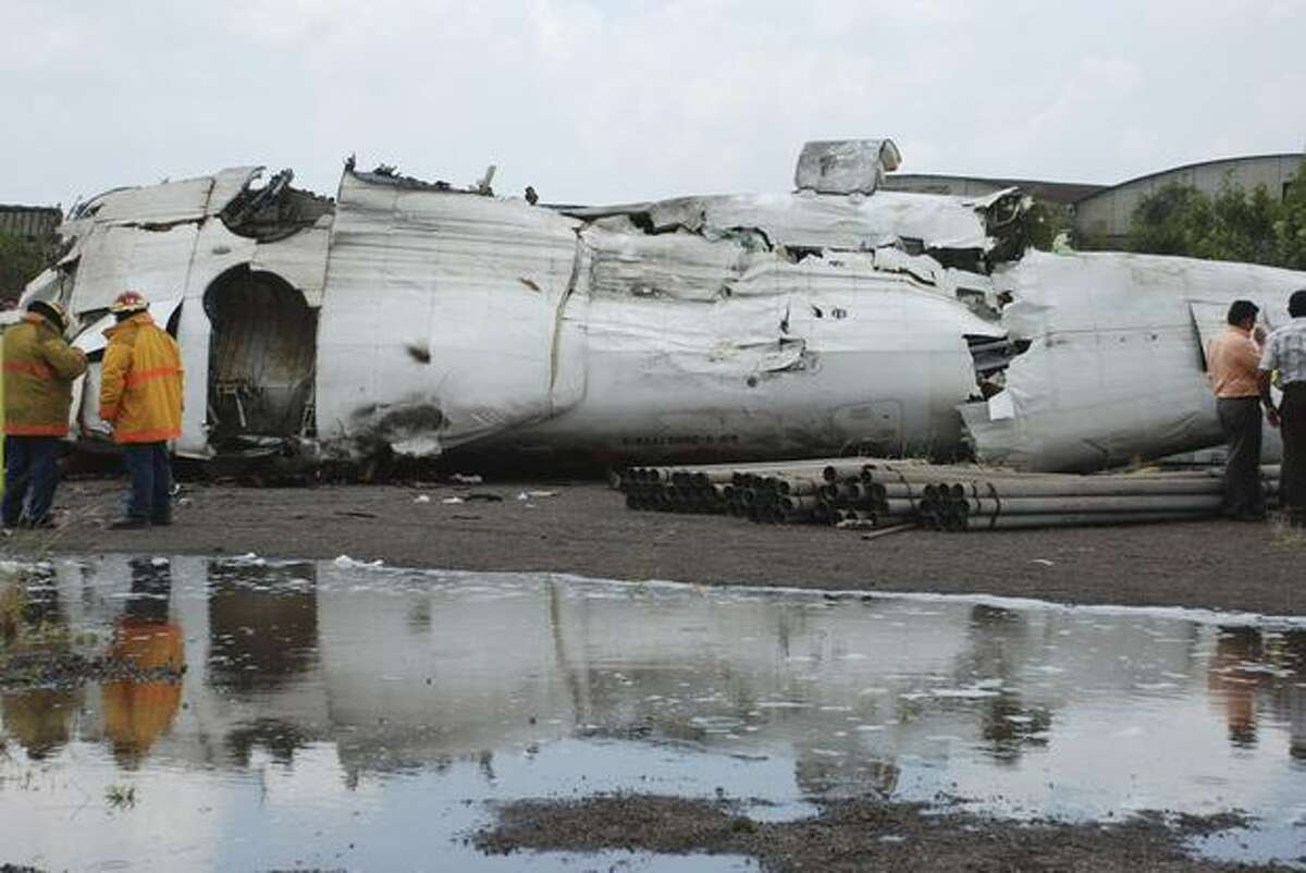 The wreckage of an airplane of a state airline Conviasa is seen on the ground after it crashed about 6 miles from the eastern city of Puerto Ordaz, Venezuela, Monday . The plane was carrying 51 people, and officials said at least 21 people survived. (AP Photo/Nicolas Serratto, Correo del Caroni)