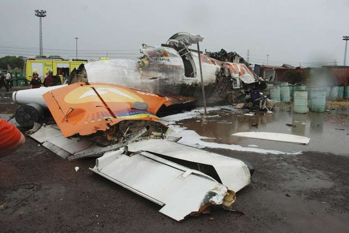 The wreckage of an airplane of a state airline Conviasa is seen on the ground after it crashed about 6 miles from the eastern city of Puerto Ordaz, Venezuela, Monday. The plane was carrying 51 people, and officials said at least 21 people survived. (AP Photo/Nicolas Serratto, Correo del Caroni)