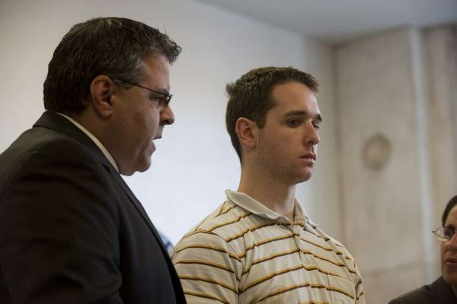Raymond Clark III (R) stands next to Assistant Public Defender Joseph E. Lopez (L) at his arraignment at the New Haven Superior Court. Earlier this morning he was arrested at a Super 8 Motel in connection with the murder of Yale University graduate student Annie Le in New Haven, Connecticut. Le, whose body was found behind a wall on September 13, in New Haven, Connecticut, had been missing since September 8, after being seen in the morning on surveillance videos entering but not leaving the laboratory building. Raymond Clark III, a lab technician at the Yale laboratory building, was taken into custody from the motel after not resisting arrest by the police as a suspect in the murder of Annie Le. Photo: Getty Images / Getty Images