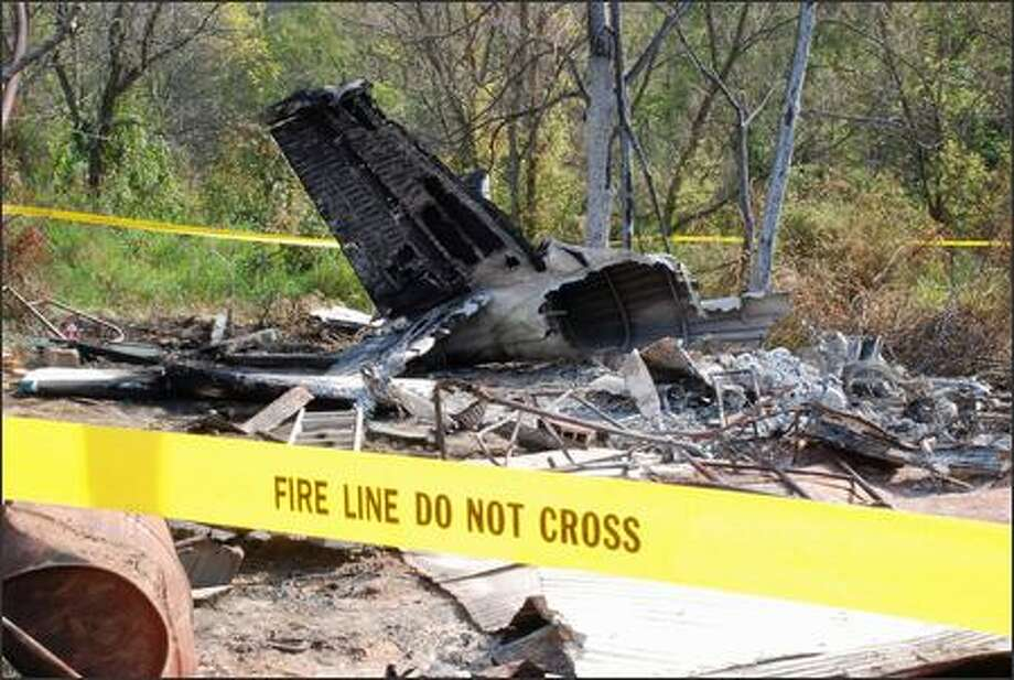Debris from a small plane that crashed Sunday remains at the crash site Tuesday, near Wiley Ford, W.Va. It will take the National Transportation Safety Board six months to a year to release a final report on the crash of a small plane that killed four people Sunday. Photo: Getty Images / Getty Images